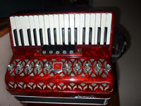 Red Piano Accordion, lightweight, 60 bass, 34 treble keys, recently tuned Exc cond.