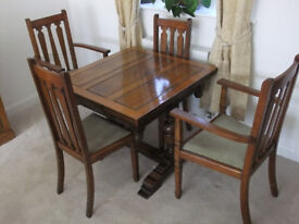 Draw leaf table and six chairs (two carvers).