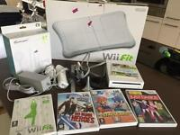 Nintendo Wii + Wii Fit + 5 games and sports accessory pack