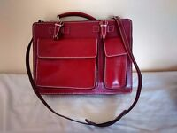 Red, real leather, handbag bought in Italy. Various compartments, short and long straps.