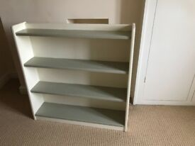 Second-hand solid wooden bookcase painted in shabby chic style