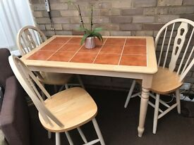 Tile topped table and four chairs.