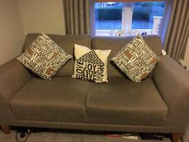 2 light grey material settees