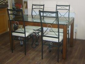 Glass / solid iron and wood dining table set. 6 x chairs.