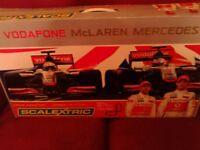 Mclaren mercedes scalextric with jenson button and Lewis Hamilton