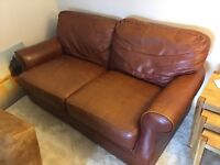 Brown Leather effect sofa, used but fresh. Very comfy!