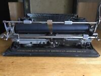hand type writer , imperial 1933 model, serial no . 90. mint condition
