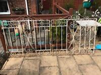 White wrought iron gates