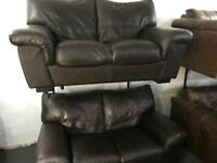 2 dark brown leather 2 seater sofas