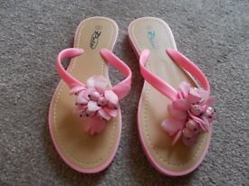 Brand new coral flip flops size 6