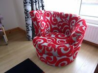 Modern 3 Seater Settee and Single Swivel Chair. Both are coloured in red, silver and black