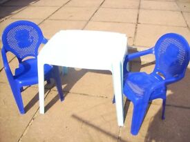 Light Blue Table with Two Dark Blue Chairs