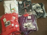 Bulk Puma clothing and Muddy fox cycling tops