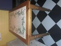 Pine table with hand painted tiles.