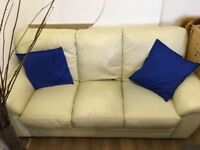 3 seater and 2 seater cream leather sofa.