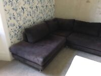 Black corner suite with silver feet - good condition