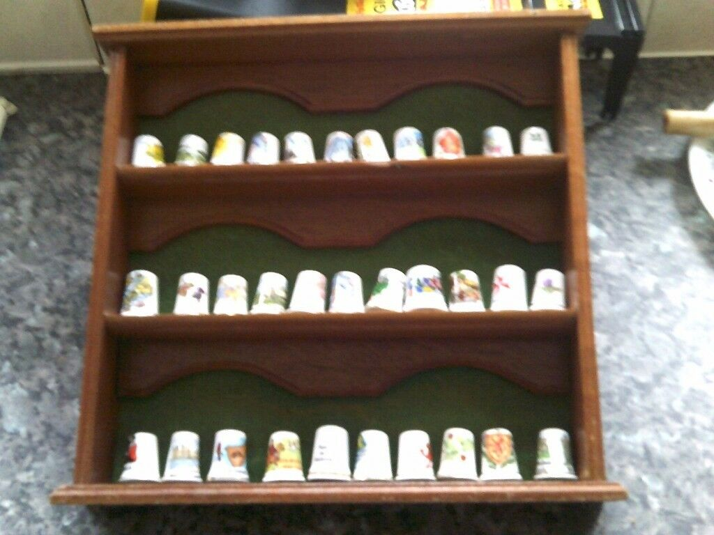 SELECTION OF CERAMIC THIMBLES WITH DISPLAY CASE