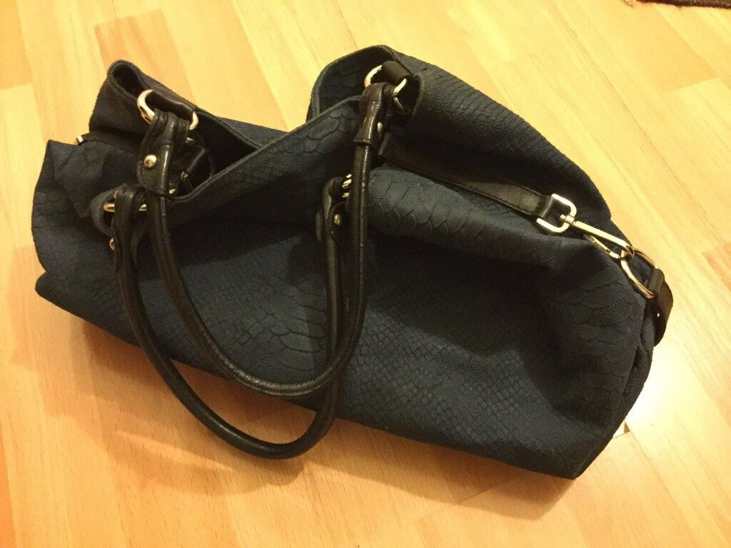 5c01c3211db Very stylish Italian leather in navy blue and black with silver  accessorised handbag