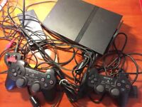 GOOD CONDITION. PS2, HAND SHANKS, GAME DVDS