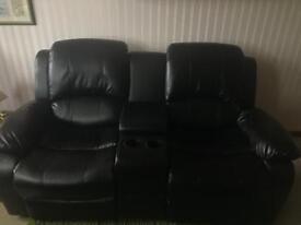 Two seater bonded leather recliner with center console
