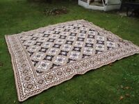 Rug or bed cover, Spanish design. Brown, cream and white colours.