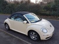 Stylish, beige VW Beetle, convertible, low milage, good condition, top car to enjoy this hot summer