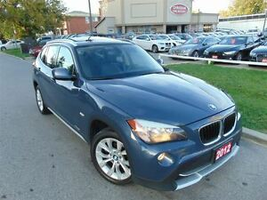 2012 BMW X1 LEATHER ROOF DUAL DVD
