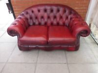 An Oxblood Red Leather Chesterfield Two Seater Sofa