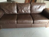 Luxury brown leather sofas.