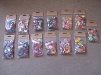 Packs of assorted coloured buttons