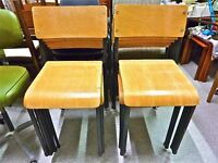 Vintage 1960's 1970's wood and metal school stacking chairs in great condition. (eight available)