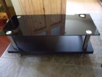 Little used smoked glass television stand
