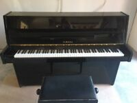 Yamaha piano- black, shiny. A fabulous piano in excellent condition. With matching piano stool.