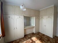 Full set of built-in wardrobes, in great condition; mirror included