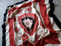 Red, black and cream patterned scarf