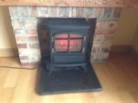 electric stove fire heating fireplace hearth mantle