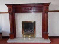 Wooden fireplace with marble hearth