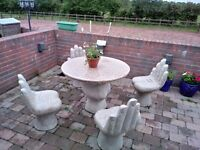 Ornate solid marble garden table and 4 marble seats styled in the shape of hands