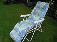 Two folding garden chairs in used but good condition.