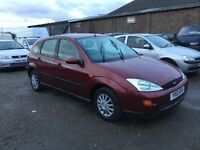 Ford Focus lx invery good condition lovely metallic burgundy unmarked grey cloth interior anytrial