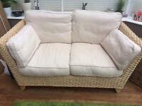 Rattan two seater sofa