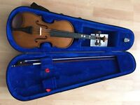 1/2 size violin for sale...v.g condition...with case...collect only...£50 (ono)
