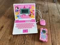 Disney dolls and toy laptop