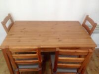 Ikea dinning table & 4 chairs with seat pads