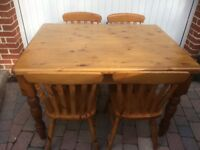 Solid pine table and 4 chairs. Ideal for dining or kitchen table.