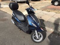 Piaggio Fly 125cc + Top Box (with very low milage)