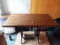 Rustic cast iron table with wooden top