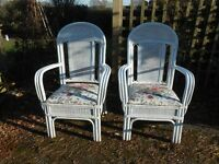 pair of white cane chairs