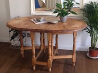 Beautiful collapsible pine dining table.