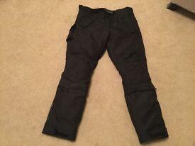 Motorbike trousers.